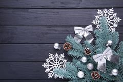 Christmas decoration. Fir-tree branch with snowflake on a black background royalty free stock photo