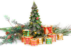 Christmas decoration. Fir tree candle and toy drums on white background Royalty Free Stock Photos