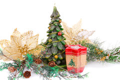 Christmas decoration. Fir tree candles and holly berry flowers   on white background Royalty Free Stock Image