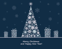 Christmas decoration with fir tree and  gift boxes. Stock Photos