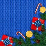 Christmas decoration with fir tree, gift, candy canes on blue kn. Itted background. Vector illustration Stock Image
