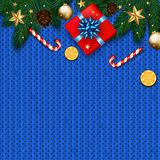Christmas decoration with fir tree, gift, candy canes on blue kn. Itted vector background Royalty Free Stock Photo