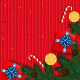 Christmas decoration with fir tree, gift, candy canes on red kni. Tted background. Vector illustration Royalty Free Stock Photo