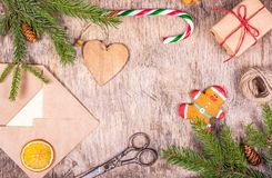 Christmas decoration with fir tree, gift, packing, envelope, toy and gingerbread. Preparing for Christmas. royalty free stock photo