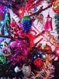 Various Christmas decoration on fir tree royalty free stock image