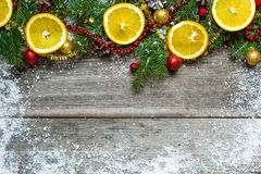 Christmas decoration with fir tree, oranges and pine cones Stock Photography
