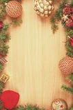 Christmas decoration with fir tree  and ornamentals on wood boar Stock Images