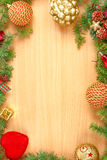Christmas decoration with fir tree  and ornamentals on wood boar Stock Photography