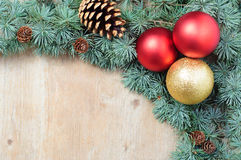 Christmas decoration fir tree and ornaments on wooden background Stock Photo