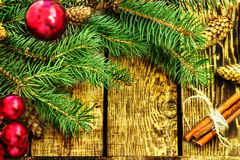 Christmas decoration of fir tree and red balls on texture wood background Royalty Free Stock Photos