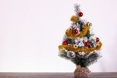 Christmas decoration, fir tree with red and silver balls and tinsel snowed royalty free stock images