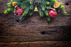 Christmas. Christmas decoration fir tree with star jingle bell and pine cone on rustic wooden table royalty free stock photo