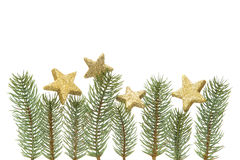 Christmas decoration, fir twigs and golden stars isolated on white background Stock Image