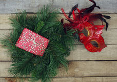 Christmas decoration: fir wreath, gift box and carnival mask Stock Image
