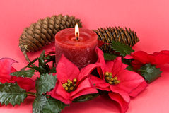 Christmas decoration with flowers and lighted cand Royalty Free Stock Photography