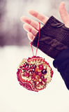 Christmas decoration in the form of a ball of red beads and crystals Stock Photos