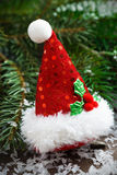 Christmas decoration in the form of hat in spruce branches Royalty Free Stock Photos