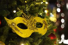 Christmas decoration in the form of a mask on the Christmas tree stock photo