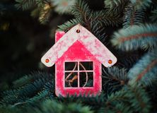 Christmas decoration in the form of a red wooden house for the new year royalty free stock photos