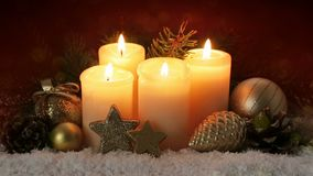 Christmas decoration and four burning Advent candles. stock video