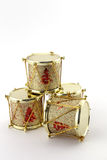 Christmas decoration with four golden drums Stock Images