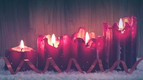 Four burning Advent candles and decoration. . Christmas background. Christmas decoration and four red advent candles stock footage