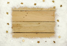 Christmas decoration, frame of artificial snow on wooden background Royalty Free Stock Image