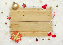 Christmas decoration, frame of artificial snow on wooden background stock photos
