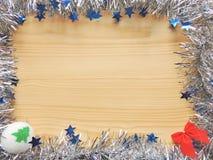 Christmas decoration frame. Christmas holiday decoration frame with silver garland and decorative elements Royalty Free Stock Photography