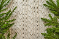 Christmas decoration frame with knitted wool background and fir. Royalty Free Stock Photos