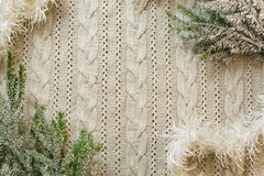 Christmas decoration frame with knitted wool background and fir. Space for text Royalty Free Stock Images