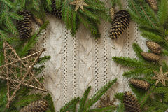 Christmas decoration frame with knitted wool background and fir. Stock Photo