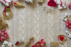 Christmas decoration frame with knitted wool background. Space f. Or text Royalty Free Stock Image