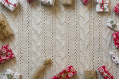 Christmas decoration frame with knitted wool background. Space f Royalty Free Stock Image