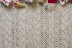 Christmas decoration frame with knitted wool background. Space f Stock Photo
