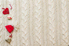 Christmas decoration frame with knitted wool background. Space f. Or text. Top view Royalty Free Stock Photography