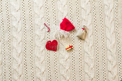 Christmas decoration frame with knitted wool background. Space f Royalty Free Stock Photos