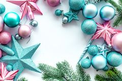 Christmas decoration frame. Pink and blue stars and balls near pine branches on white background top view copyspace Royalty Free Stock Photo