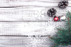 Christmas decoration frame on white rustic wooden background wit Royalty Free Stock Photos