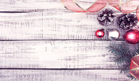 Christmas decoration frame on white rustic wooden background wit Stock Photography