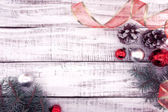 Christmas decoration frame on white rustic wooden background wit Stock Image