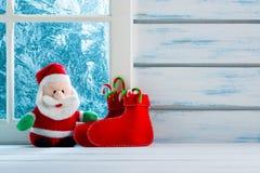 Christmas decoration, frozen window. Scene Royalty Free Stock Photography