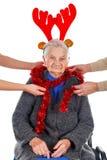 Christmas decoration and fun with Grandma Royalty Free Stock Photos