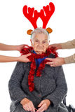 Christmas decoration and fun with Grandma Stock Photos