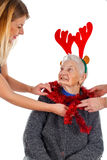 Christmas decoration and fun with Grandma Royalty Free Stock Photo