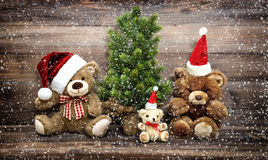 Christmas decoration with funny toys Teddy Bear family in snow Royalty Free Stock Image