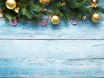Christmas decoration with fur and baubles Stock Photos