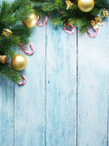 Christmas decoration with fur and baubles. On old wood Stock Images