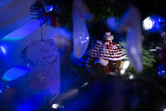 Christmas decoration on fur-tree in blue lights Royalty Free Stock Photos