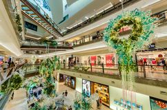 Christmas decoration in The Gardens Mall. People can seen exploring and shopping around it. Royalty Free Stock Image